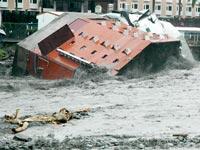 בית מלון שקורס תחת השיטפונות העזים של סופת הטייפון מריקוט  טוויאן /צלם: רויטרס